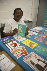 Community Impact Haringey, Volunteer, at Health Watch Stand.
