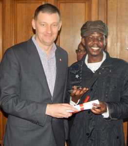 Haringey-Young-Hero-Volunteer-Limudin-Ali-aka-Limz-of-the-Year-receives-his-award-from-Haringey-Chief-Executive-Nick-Walkley